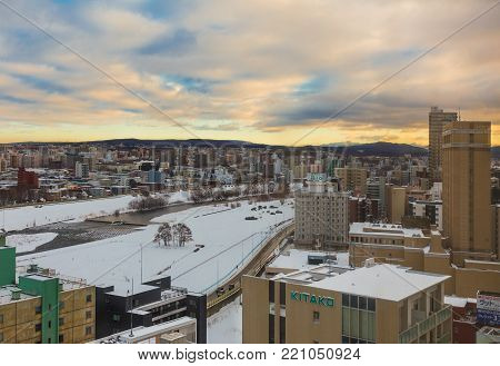 Otaru, Hokkaido, Japan - 30 December 2017 - View of city of Otaru covers with snow in the winter during beautiful sunset of December 30, 2017 in Otaru, Hokkaido, Japan
