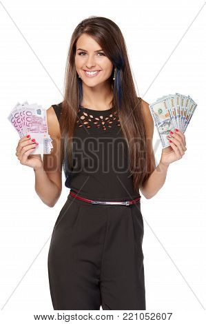 Happy young woman holding us dollar money in one hand and euro cash money in another hand, over white background