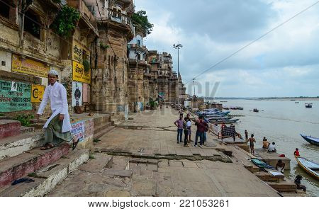 Varanasi, India - Jul 12, 2015. People walking on ghats in Varanasi, India. Varanasi is the holiest of the seven sacred cities (Sapta Puri) in Buddhism, Hinduism and Jainism.