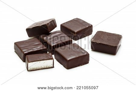 A bunch of chocolate candies isolated on white background, bird's milk
