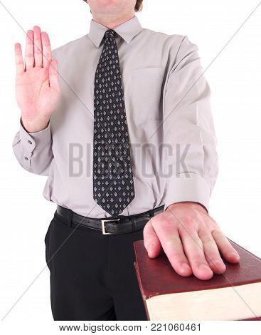 a man taking an oath on a bible.