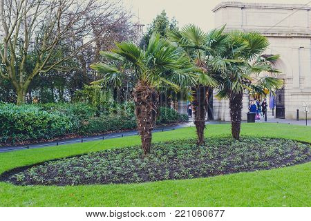 DUBLIN, IRELAND - January 6th, 2018: Saint Stephen's Green park in Dublin city centre on a calm, overcast and cold winter day with view over the entrance Arch