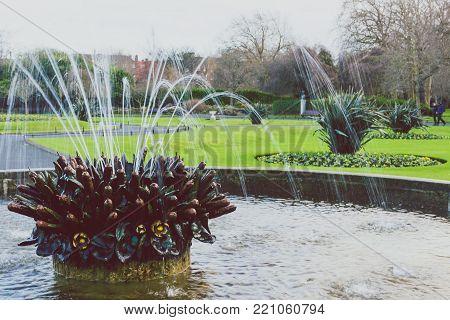 DUBLIN, IRELAND - January 6th, 2018: fountain in Saint Stephen's Green park in Dublin city centre on a calm, overcast and cold winter day