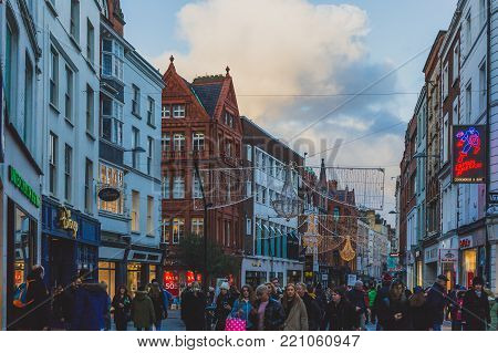 DUBLIN, IRELAND - January 6th, 2018: crowded Grafton Street in Dublin city centre with festive Christmas decorations