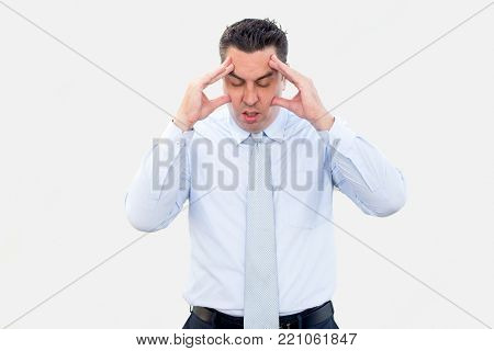 Closeup portrait of thoughtful middle-aged business man touching face and thinking hard with his eyes closed. Contemplation concept. Isolated front view on white background.