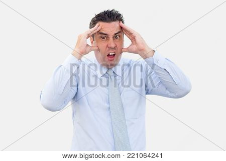 Closeup portrait of stressed middle-aged business man touching face. Stress concept. Isolated front view on white background.