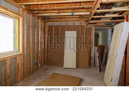 unfinished wood frame building or a house under construction