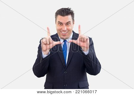 Cheerful enterprising businessman offering strategy and gesturing while explaining it to pay attention. Positive successful speaker presenting his business idea. Business results concept