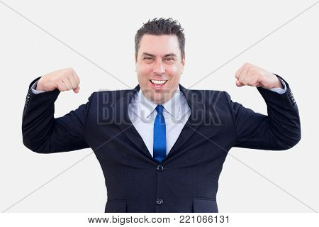 Cheerful powerful businessman showing his biceps like it is symbol of big opportunities. Jolly handsome male employee believing in his efforts. Opportunities concept