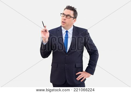 Introspective contemplative male analyst thinking of sales. Pensive handsome businessman working on project and holding pen elaborating business strategy. Business week concept
