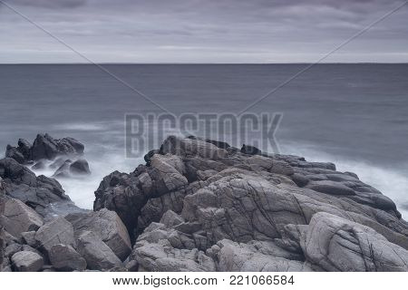 Rocky beach landscape at dusk. Kullaberg, Sweden.