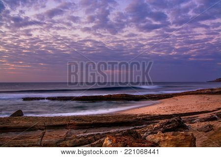 View of the Pedra Branca beach in Ericeira village, Portugal on the late afternoon.