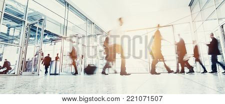crowd of anonymous business people rushing at a entrance in a shopping mall. ideal for websites and magazines layouts