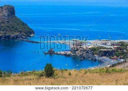 Beautiful Calabrian Tyrrhenian sea coastline landscape, small rocky island Isola di Dino and Torre di Fiuzzi, Praia A Mare, Calabria, Italy. People unrecognizable.