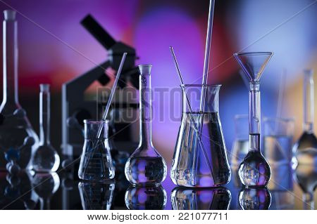 Science experiment concept background. Laboratory beakers, pipette.  Bokeh background.