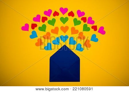 Greeting envelope with paper hearts on yellow background. Hearts pours out of the envelope. Hearts fly out from the envelope. Love Letter.