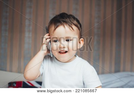 Baby Talking On A Mobile Phone