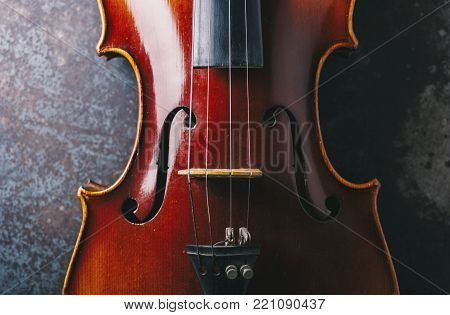 Old Violin With Bow On A Wooden Floor