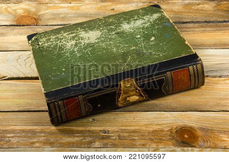 Ancient book, hardcover on a wooden table. Back to school. Copy space for text. The concept of education