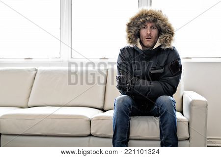 A Man With Warm Clothing Feeling The Cold Inside House