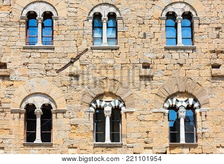 Palazzo dei Priori wall in ancient walled mountaintop town Volterra, construction  finished in 1257, Pisa province, Tuscany, Italy.