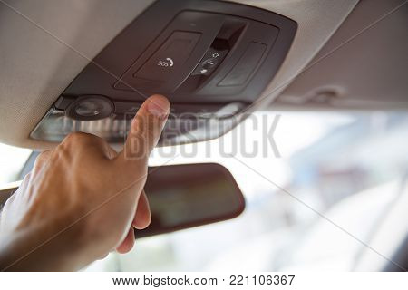Emergency call assistance. Man's finger pressing emergency sos button to contact with call center to ask for help after car accident