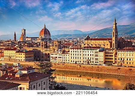 Florence, Tuscany, Italy: landscape of the city with the Cathedral of Santa Maria del Fiore, the Basilica of Santa Croce, the National Central Library and the Arno river