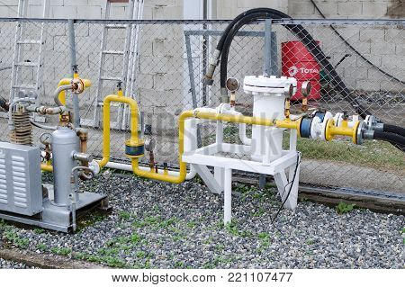 Batumi, Georgia, 11-22-2017: Gas supply system at the refill station - pressure gauges, pipes, compressors.