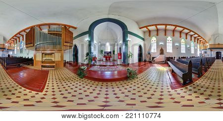 GRODNO, BELARUS - JUNE 19, 2014: 360 panorama view in interior of Lutheran German church near altar with organ. Full 360 by 180 degrees seamless panorama  in equirectangular spherical projection.