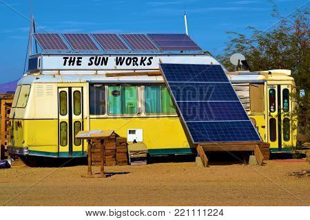 January 2, 2018 in Slab City, CA:  Camper trailer with solar panels including a sign which says