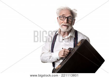 Waist up portrait of grey haired retiree with suitcase looking stunned. Copy space in left side. Isolated on background