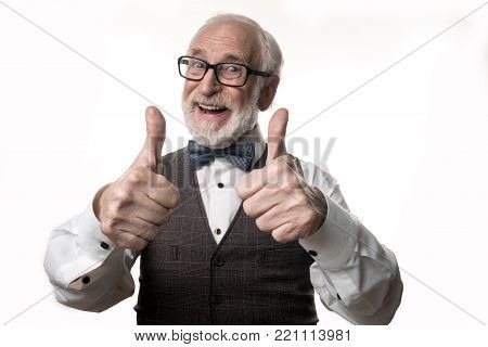 Super. Waist up portrait of bearded elderly man giving his thumbs up and laughing. Isolated on background