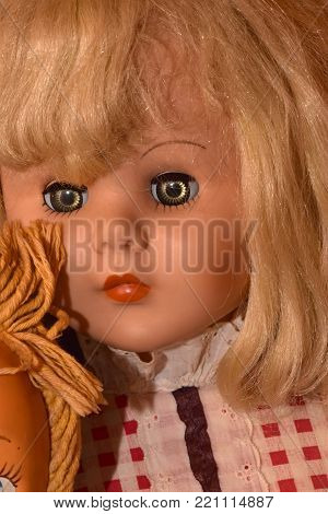 Creepy vintage dolls with unsettling expressions close up portraits.