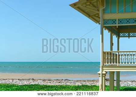 Beach house with sea view and blue sky in vintage design. Vacation home for family relax.