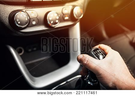 Detail of a driver hand shifting the gear stick