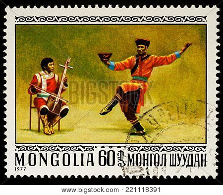 Moscow, Russia - January 08, 2018: A stamp printed in Mongolia, shows Bielge west Mongolian trunk dance, series