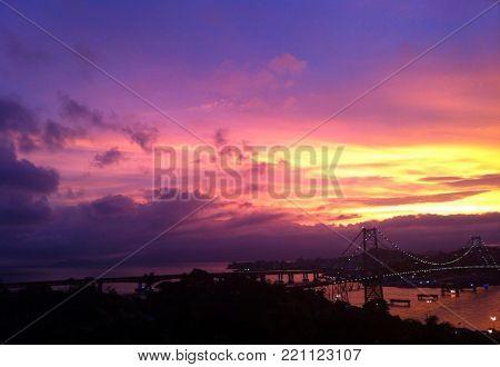 a beautiful sunset at hercilio luz bridge