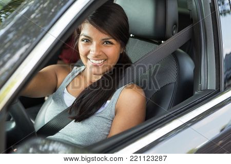 Young Hispanic teenage girl excited about driving.