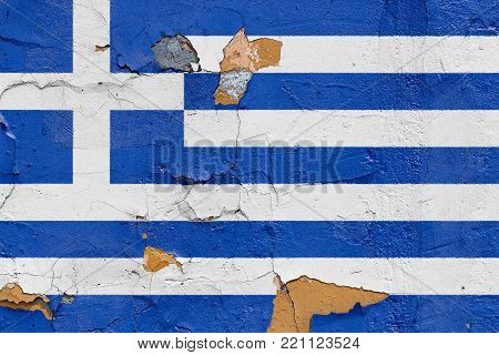 Greece flag painted on a weathered concrete wall