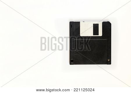 A Black floppy disk on white background,blank for copy space.