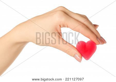 Jelly heart candy sweets in hand on white background isolation