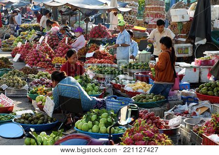 HO CHI MINH CITY, VIET NAM- NOV 21, 2017: Amazing scene of fruits market at Cho Lon, Vietnam in early morning, colorful fruit basket show at open air market, crowded and busy street