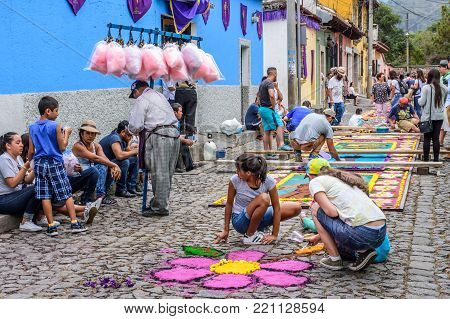 Antigua, Guatemala -  April 13, 2017: Making dyed sawdust carpets for Holy Thursday procession in town with most famous Holy Week celebrations in Latin America