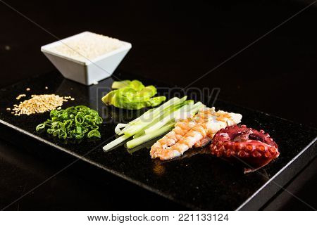 Close up of raw and fresh ingredients and seafood for japanese sushi roll