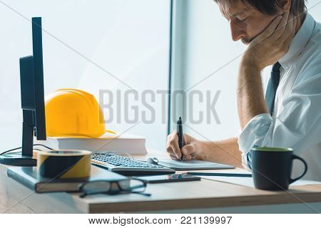 Interior design professional working on graphic tablet sketch pad in architecture studio office
