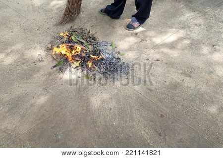 Sweep leaves and burn leaves stack in the garden