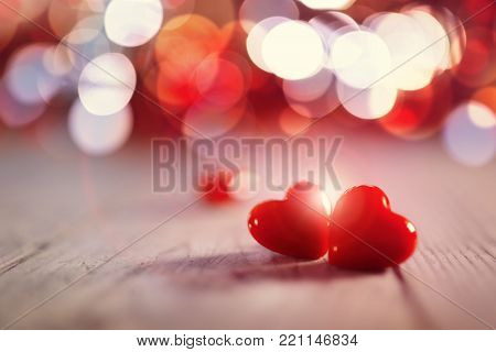 Two valentines day hearts on a wooden background concept for love, dating and romance with copy space