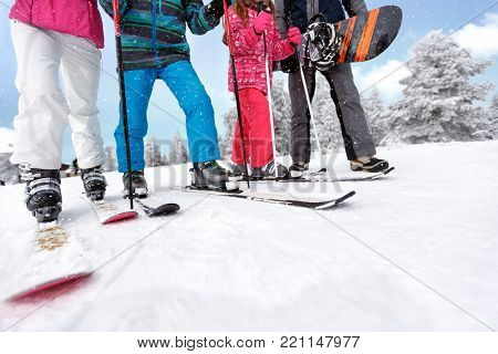 Skiers legs with ski shoes and skis on ski terrain, close up