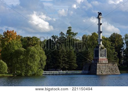 PUSHKIN, ST. PETERSBURG, RUSSIA - SEPTEMBER 20, 2015: Chesme Column in the Grand pond of the Catherine park. The column was erected in 1774-1778 by design of Antonio Rinaldi