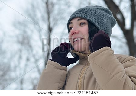 Winter Portrait Of Young Girl With Smartphone